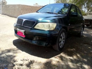 Mitsubishi lancer. Model :2003. Good condition nothing any iso. Ac 100 % okay.